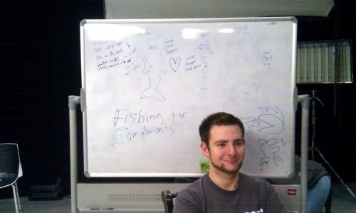 TomSka in front of a Board